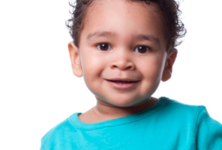 Smiling child wearing a blue shirt